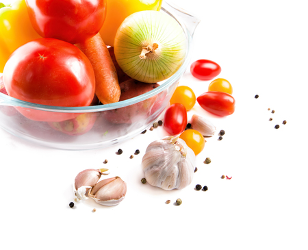 vegeterian: Fresh vegetables in a glass pot isolated on white background. Ready set for vegeterian dinner like ratatouille. With space for a text.