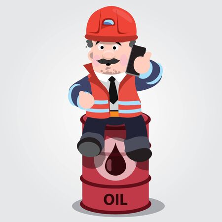 A man in a working form with a mobile phone sitting on a barrel of fuel
