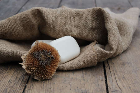 deadwood: Natural white soap on a background of burlap and deadwood. Stock Photo