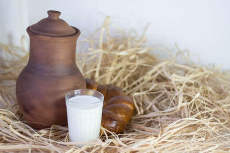 bum: Brown clay jug and bum and cup of dry grass