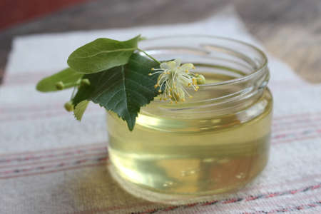 basswood: Linden flower and bee natural lime honey in a jar