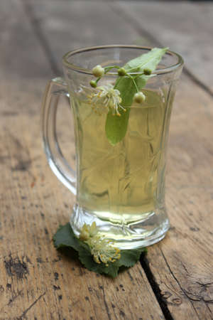 linden blossom: Glass cup with handle with linden tea and linden blossom