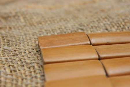Rectangular wooden lacquered boards on lianna fabric