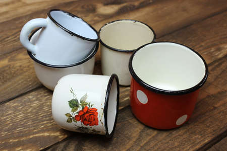 Very old enamel cups on the boards