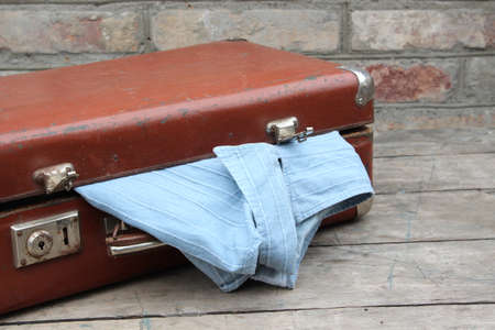 Old brown suitcase with clothes