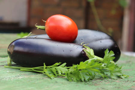Eggplant fruits on wooden boards. Agriculture