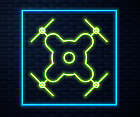Glowing neon line Drone flying icon isolated on brick wall background. Quadrocopter with video and photo camera symbol. Vector Illustration