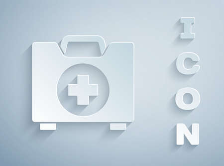 Paper cut First aid kit icon isolated on grey background. Medical box with cross. Medical equipment for emergency. Healthcare concept. Paper art style. Vector Illustration Ilustracja