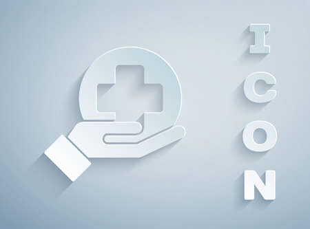 Paper cut Cross hospital medical icon isolated on grey background. First aid. Diagnostics symbol. Medicine and pharmacy sign. Paper art style. Vector Illustration Vettoriali