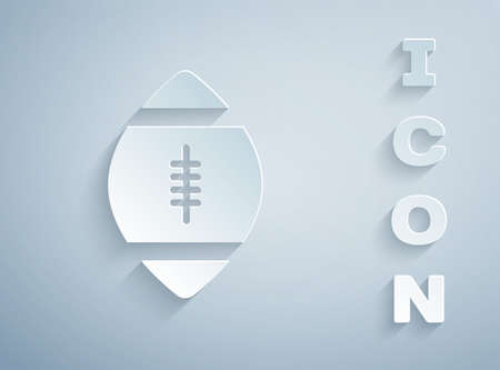 Paper cut American Football ball icon isolated on grey background. Rugby ball icon. Team sport game symbol. Paper art style. Vector Illustration 向量圖像