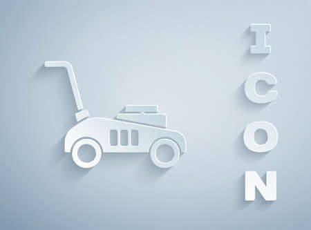 Paper cut Lawn mower icon isolated on grey background. Lawn mower cutting grass. Paper art style. Vector Illustration.