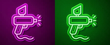 Glowing neon line Paint spray gun icon isolated on purple and green background. Vector Illustration