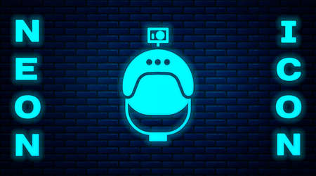 Glowing neon Helmet and action camera icon isolated on brick wall background. Vector Illustration