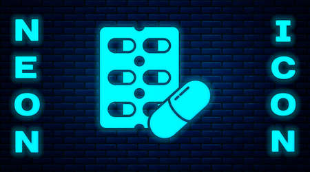 Glowing neon Pills in blister pack icon isolated on brick wall background. Medical drug package for tablet, vitamin, antibiotic, aspirin. Vector Illustration.