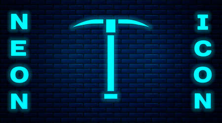 Glowing neon Pickaxe icon isolated on brick wall background. Vector Illustration.