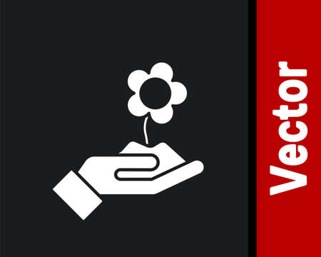White Hand holding flower icon isolated on black background. Seed and seedling. Planting sapling. Ecology concept. Vector Illustration. Illustration