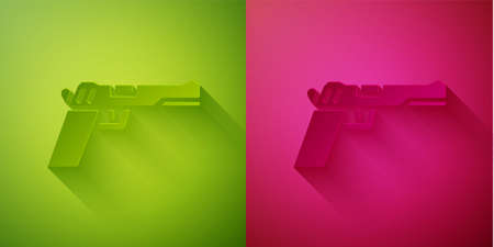Paper cut Pistol or gun icon isolated on green and pink background. Police or military handgun. Small firearm. Paper art style. Vector Illustration.