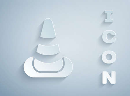 Paper cut Traffic cone icon isolated on grey background. Paper art style. Vector