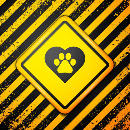 Black Heart with animals footprint icon isolated on yellow background. Pet paw in heart. Love to the animals. Warning sign. Vector  イラスト・ベクター素材