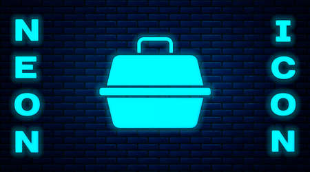 Glowing neon Pet carry case icon isolated on brick wall background. Carrier for animals, dog and cat. Container for animals. Animal transport box. Vector.