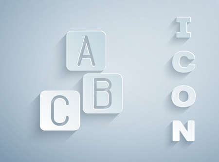 Paper cut ABC blocks icon isolated on grey background. Alphabet cubes with letters A,B,C. Paper art style. Vector.