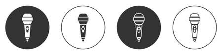 Black Microphone icon isolated on white background. On air radio mic microphone. Speaker sign. Circle button. Vector Illustration.