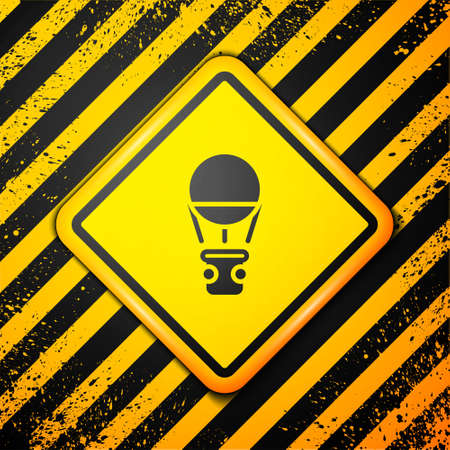 Black Hot air balloon icon isolated on yellow background. Air transport for travel. Warning sign. Vector