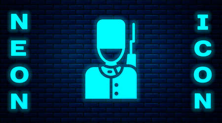 Glowing neon British guardsman with bearskin hat marching icon isolated on brick wall background. Vector
