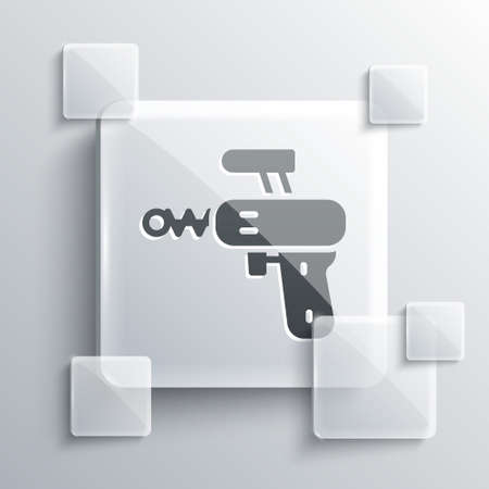 Grey Ray gun icon isolated on grey background. Laser weapon. Space blaster. Square glass panels. Vector