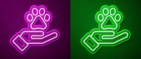 Glowing neon line Hands with animals footprint icon isolated on purple and green background. Pet paw in heart. Love to the animals. Vector