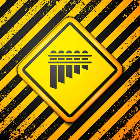 Black Pan flute icon isolated on yellow background. Traditional peruvian musical instrument. Zampona. Folk instrument from Peru, Bolivia and Mexico. Warning sign. Vector