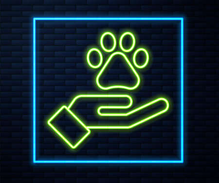 Glowing neon line Hands with animals footprint icon isolated on brick wall background. Pet paw in heart. Love to the animals. Vector
