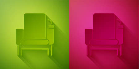 Paper cut Cinema chair icon isolated on green and pink background. Paper art style. Vector Illustration
