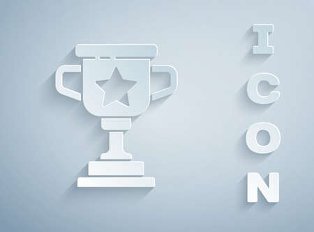 Paper cut Award cup icon isolated on grey background. Winner trophy symbol. Championship or competition trophy. Sports achievement sign. Paper art style. Vector