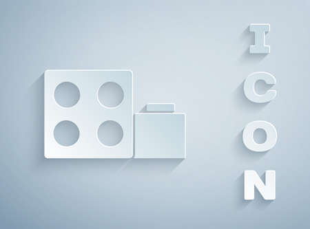 Paper cut Toy building block bricks for children icon isolated on grey background. Paper art style. Vector