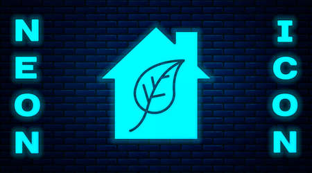 Glowing neon Eco friendly house icon isolated on brick wall background. Eco house with leaf. Vector
