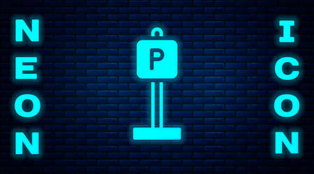 Glowing neon Parking icon isolated on brick wall background. Street road sign. Vector