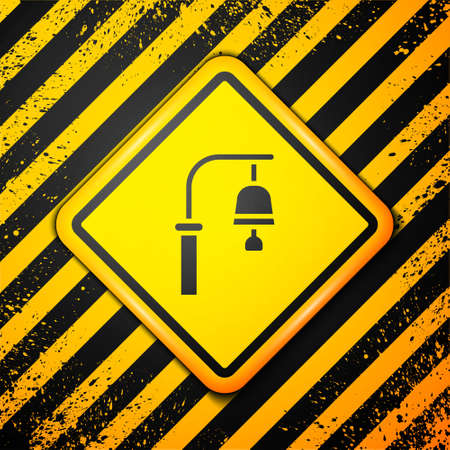 Black Train station bell icon isolated on yellow background. Warning sign. Vector
