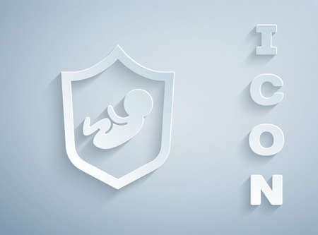 Paper cut Baby on shield icon isolated on grey background. Child safety sign. Paper art style. Vector