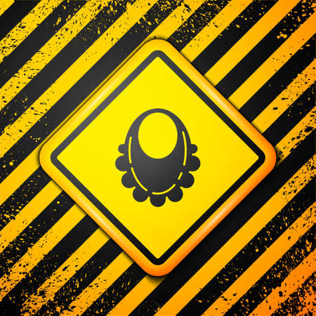 Black Baby bib icon isolated on yellow background. Warning sign. Vector