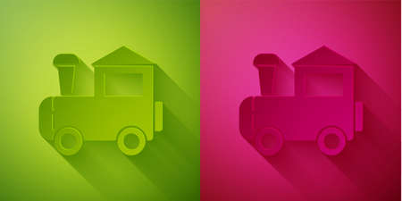 Paper cut Toy train icon isolated on green and pink background. Paper art style. Vector