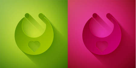 Paper cut Baby bib icon isolated on green and pink background. Paper art style. Vector