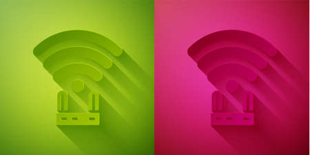 Paper cut Router and wi-fi signal icon isolated on green and pink background. Wireless ethernet modem router. Computer technology internet. Paper art style. Vector 向量圖像