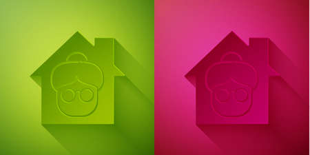 Paper cut Nursing home building icon isolated on green and pink background. Health care for old and sick people. Center for retired people. Paper art style. Vector