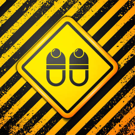 Black Slippers icon isolated on yellow background. Flip flops sign. Warning sign. Vector