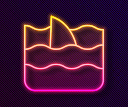 Glowing neon line Shark fin in ocean wave icon isolated on black background. Vector