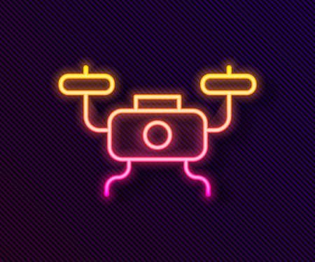 Glowing neon line Drone flying icon isolated on black background. Quadrocopter with video and photo camera symbol. Vector