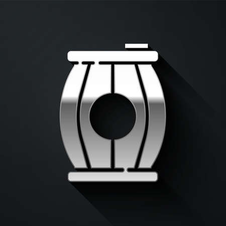 Silver Gun powder barrel icon isolated on black background. TNT dynamite wooden old barrel. Long shadow style. Vector