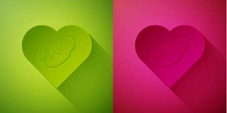 Paper cut Baby inside heart icon isolated on green and pink background. Paper art style. Vector