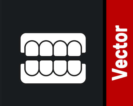 White False jaw icon isolated on black background. Dental jaw or dentures, false teeth with incisors. Vector Stock Illustratie